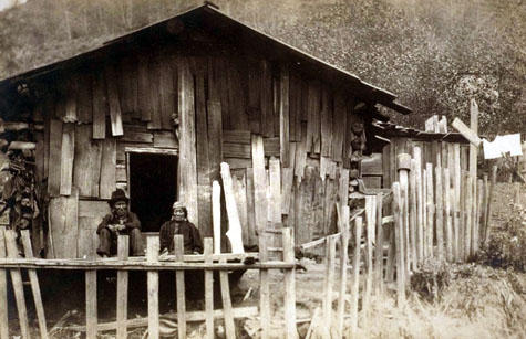 Tolowa Tribal people and their plankhouse c. 1900