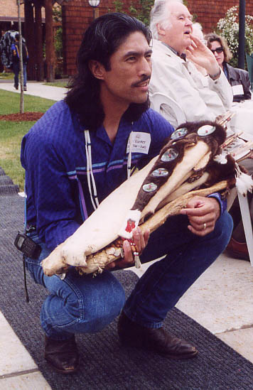 Jason Younker Kneeling with SWORP gift, 2001