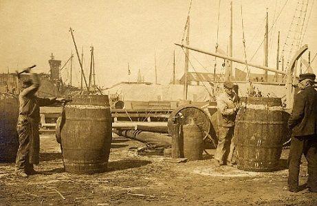 Barrels being loaded on ships bound for international trade